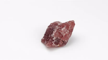 nugget : Strawberry quartz nugget on a white background. Rotation Decorative and ornamental stone.