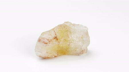nugget : Citrine on a white background. Mineral Rotation Decorative and ornamental stone. Nugget close up view. Jewelcrafting.