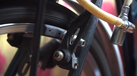 ciclismo : Bicycle wheel with spokes spinning moves, break in action