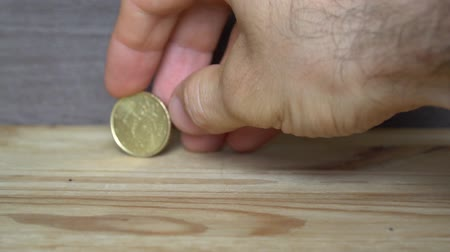 цент : Business concept - man hand twist an euro coin