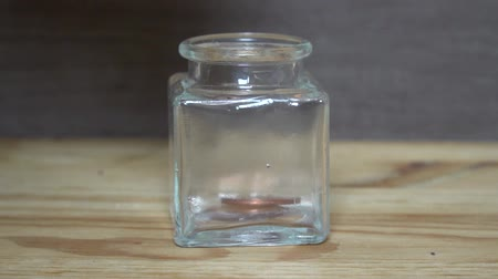 skarb : Business concept - man hand throw euro coins into little transparent jar