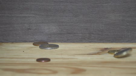 cent : Business concept - euro coins drop down to wooden table.