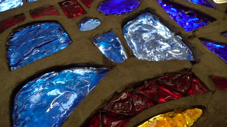 stained glass : Glass mosaic from different pieces with colorful lights in motion Stock Footage