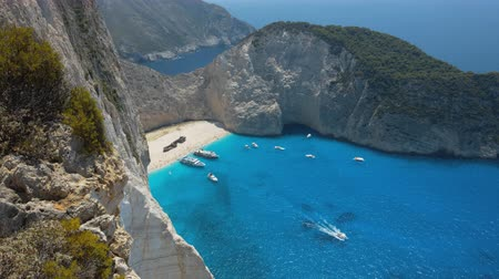 navagio : Aerial footage of sea bay with beach and many boats