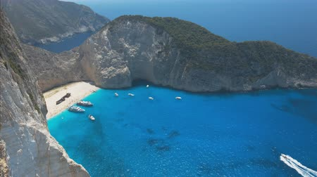 navagio : Panorama footage of sea bay with beach and many boats Stock Footage