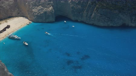 navagio : Timelapse footage of sea bay with beach and many boats