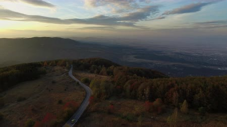 esinti : Autumn landscape from the air in the late afternoon with sunset and meandering road