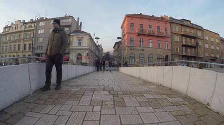 bascarsija : SARAJEVO, BOSNIA - JAN 25, 2018:Latin Bridge is an Ottoman bridge over the river Miljacka in Sarajevo.The northern end of the bridge was the site of the assassination of Archduke Franz Ferdinand of Austria by Gavrilo Princip in 1914.