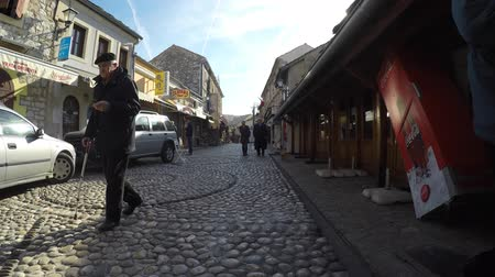 reconstructed : MOSTAR, BOSNIA - JAN 26, 2018: Street in the Old Town, Mostar in Bosnia-herzegovina. The name Mostar itself means bridge-keeper