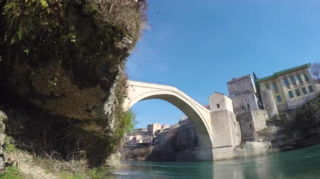 reconstructed : Stari Most (Old Bridge) is a rebuilt 16th-century Ottoman bridge in the city of Mostar in Bosnia that crosses the river Neretva and connects the two parts of the city.