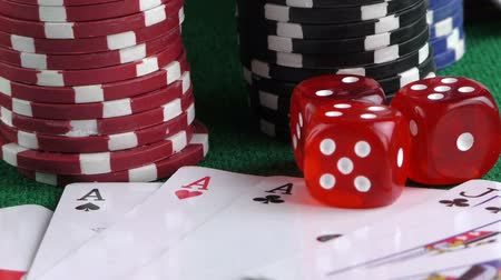szerencsejáték : Gambling Red Dice Poker Cards and Money Chips Stock mozgókép