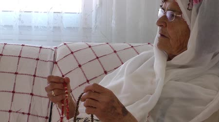 clergy : Old Woman Prays with Rosary