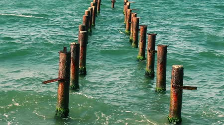 vrak : Rusty poles in the sea