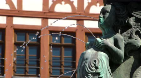 oper : Fountain Water Falls From Statue in Frankfurt Germany