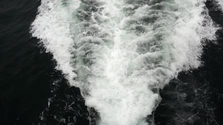 aqueous : Sea waves behind ferryboat