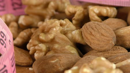 walnut shell : Almond and Walnut and Measurement Macro View Stock Footage