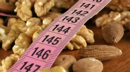 hazelnuts : Almond and Walnut and Measurement Macro View Stock Footage