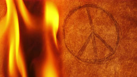 unicef : Peace Symbol in On Old Paper Burning Fire Stock Footage