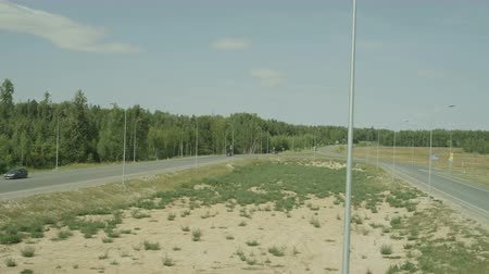 avançar : air plan camera move along the lamppost to the LED lamp with the country road with forest in background Stock Footage