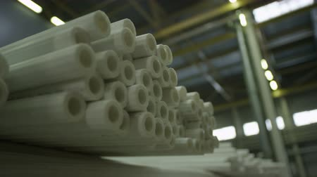 típico : closeup long white polyethylene pipes in big production factory storehouse in Alabbuga Russia