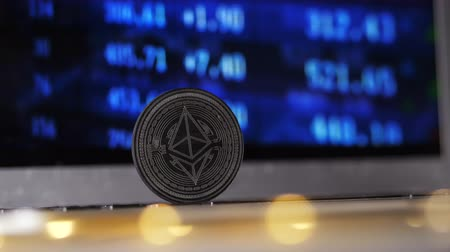 finança : closeup famous black ethereum coin model against the screen