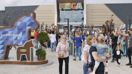 conversa : KAZAN, TATARSTAN  RUSSIA - SEPTEMBER 19 2017: Nice playground with large swing at Mega store and wooden horses with words where Ikea there summer on September 19 in Kazan