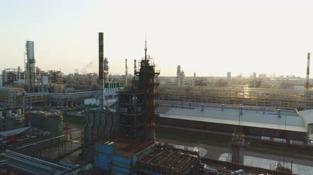 localização : drone rotates above manufacturing departments and oil tanks located on petroleum plant territory Stock Footage