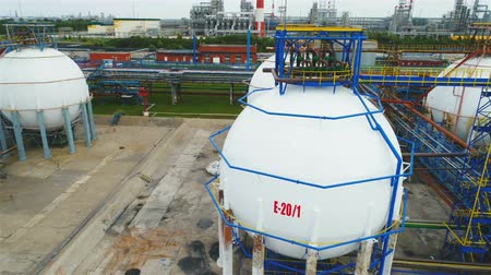 cercar : drone rotates above huge oil tanks