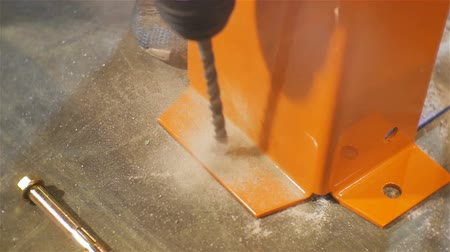 distribution lectrique : closeup worker drills bolthole with powerful tool for limiting construction with concrete floor Stock Footage