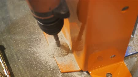 distribution lectrique : closeup top view worker drills bolthole with powerful tool for limiting construction with concrete floor Stock Footage