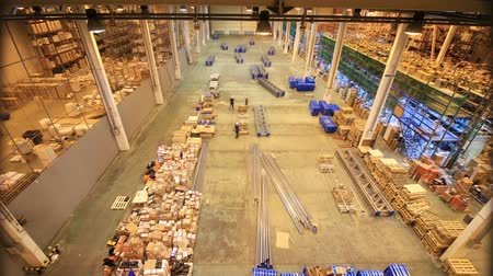 distribution lectrique : timelapse upper view modern metal racks assembling and loading professional process in a large warehouse
