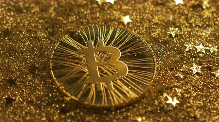 benzer : macro sparkling golden stars fall on bitcoin model with unique qualities made coin similar to precious metals