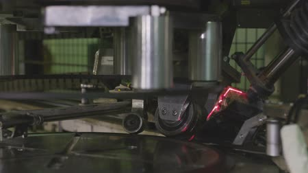 aro : closeup equipment marks tire rim during the production process in the industrial company department Stock Footage