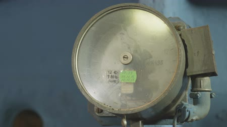 rozchod : slow motion closeup old pressure gauge with arrow and green sticker on screen