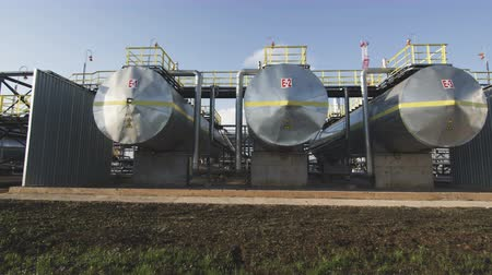 węgiel : gray petrochemical cisterns fenced and surrounded by metal stairs