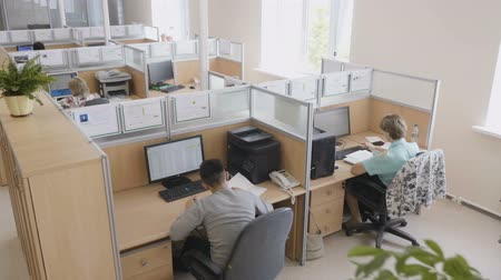 mühendislik : KAZAN, TATARSTAN  RUSSIA - AUGUST 15 2017: Upper view large light office with modern equipment on workplaces and skilled employees on August 15 in Kazan Stok Video