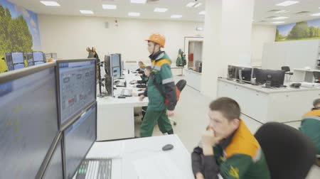 hydrocarbon : KAZAN, TATARSTAN  RUSSIA - SEPTEMBER 19 2017: Closeup refinery staff in uniforms sits at computers and controls Stock Footage