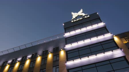 hydrocarbon : KAZAN TATARSTAN  RUSSIA - AUGUST 21 2017: Closeup illuminated administrative building of holding chemical processing in the evening on August 21 in Kazan Stock Footage
