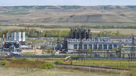 petroleum refinery : upper view modern gas refinery complex in pictorial green valley against distant forestry mountains Stock Footage
