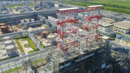 oil refinery : aerial view high structure located on gas company territory with gasoline tanks pipelines against green landscape