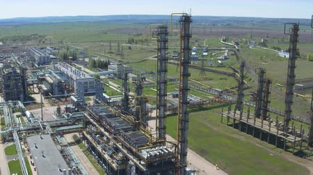 petroleum refinery : aerial view metal towers constructions and powerful equipment located on industrial plant territory