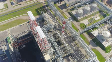 distillation : upper view powerful distillation station with pipelines at modern gas refinery plant among fresh lawns
