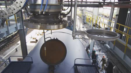 lower part : closeup automatic metal connective part open and lowers on large gas tank Stock Footage