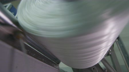 závit : macro glass thread winding to bobbin in workshop