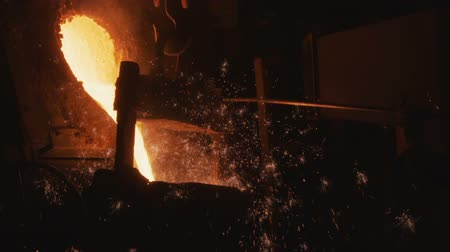 demirli : hot metal pours out of bucket in steel making shop
