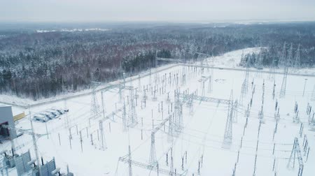 pilon : electrical transmission substation against forest Stock mozgókép