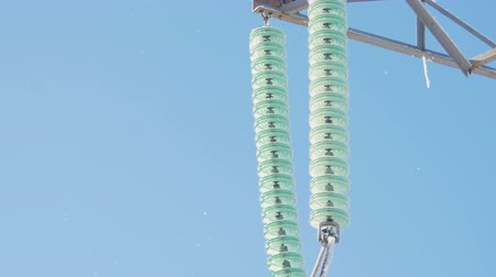 pilon : ceramic isolators covered with hoarfrost on tower
