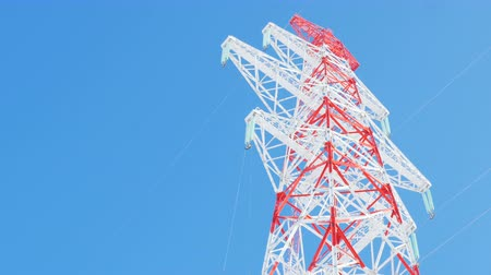 pilon : red and white high voltage tower against clear sky