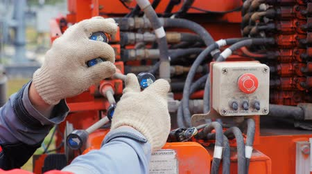 watt : electrician moves control levers in power box
