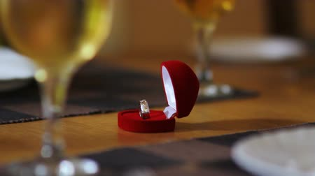 romance : registrar takes ring from table to navigate wedding ceremony